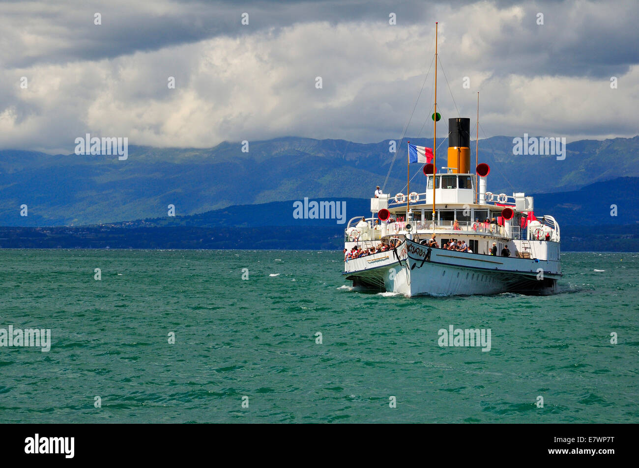 Paddle steamer Simplon on Lake Geneva or Lac Leman with storm clouds, Yvoire, Rhone-Alpes, Haute-Savoie, France - Stock Image