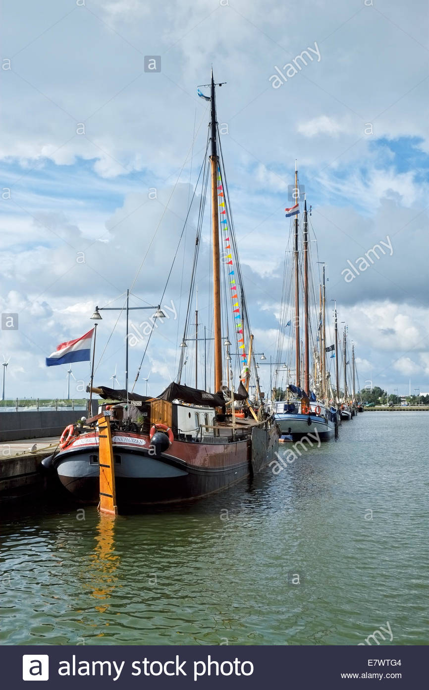 Tall ships are anchored in the harbor of the Dutch city of Enkhuizen, located on the IJsselmeer north of Amsterdam. - Stock Image