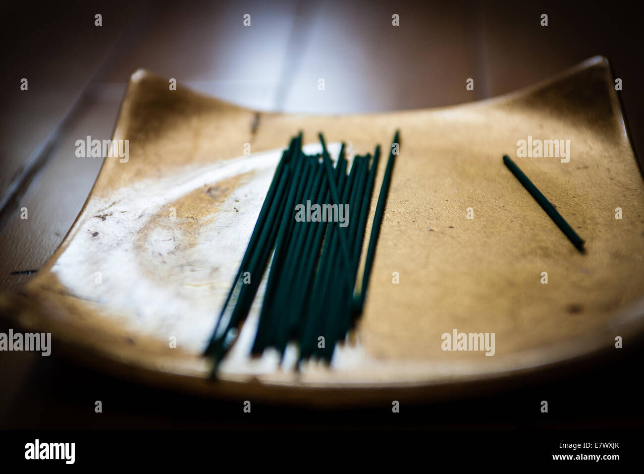 A Buddhist shrine with incense ready for meditation and puja - Stock Image