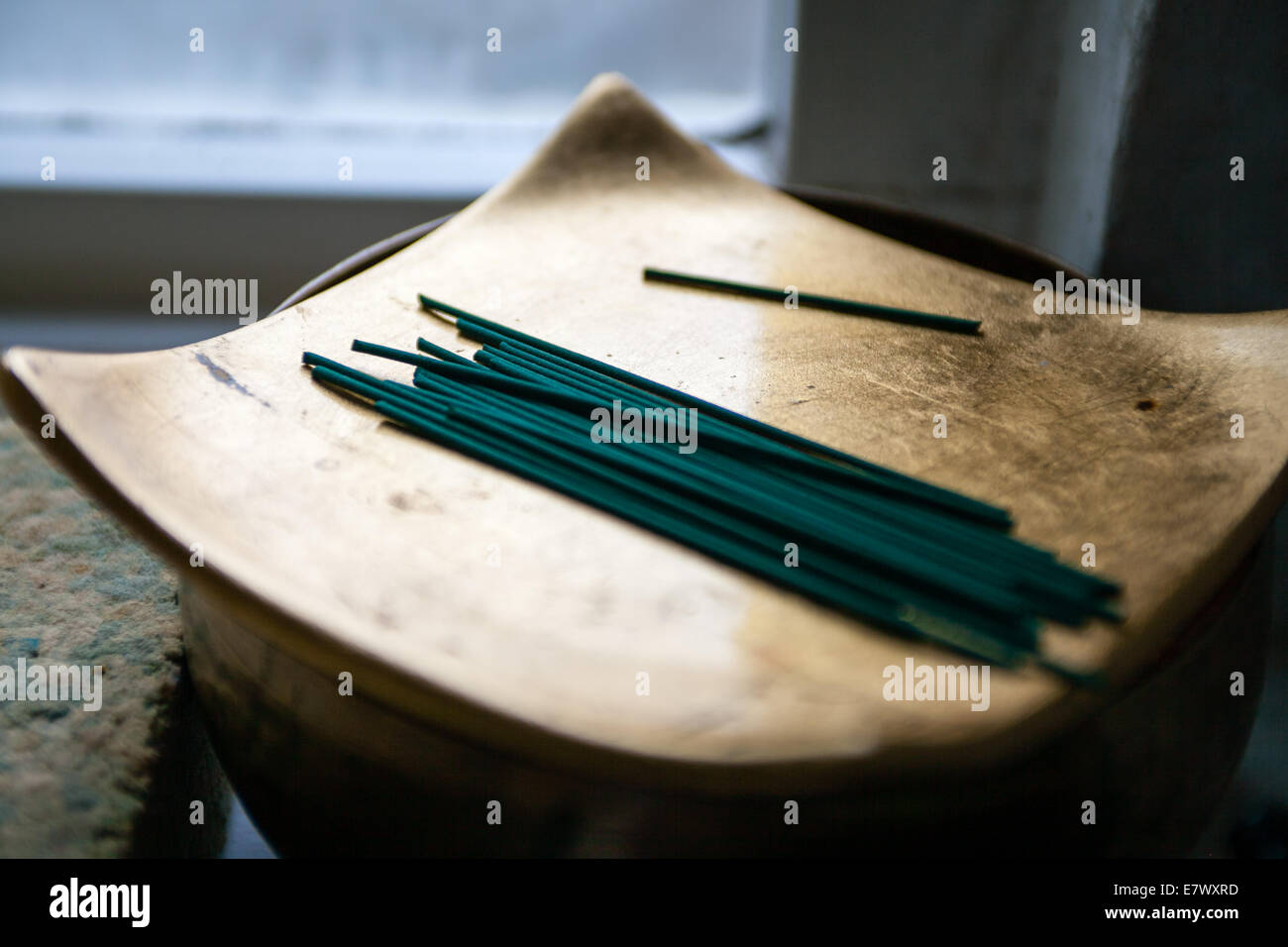 Buddhist incense ready for meditation and puja - Stock Image
