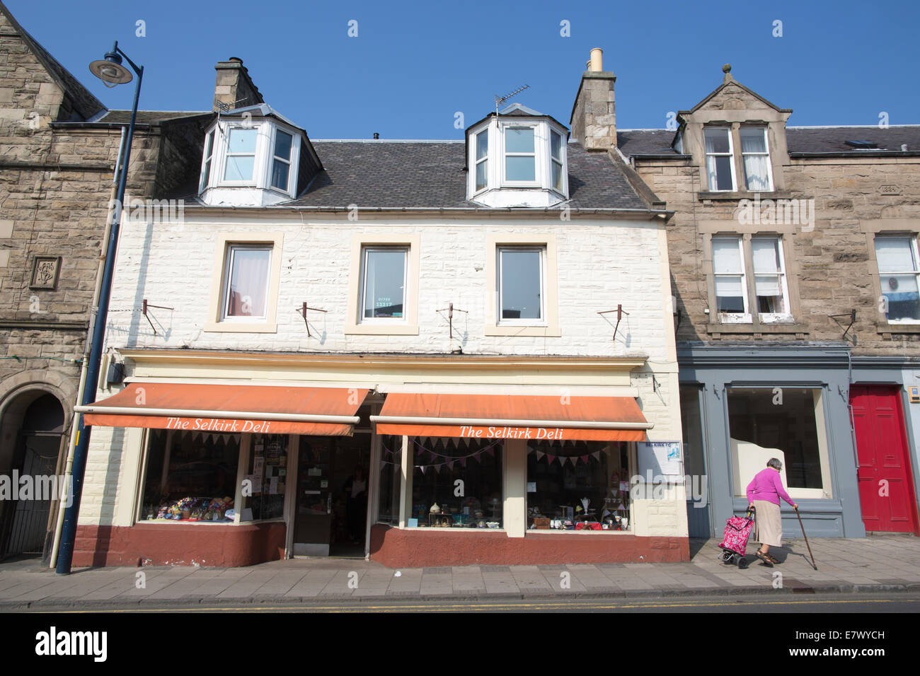 Shops on the high street of Selkirk, The Royal and Ancient Burgh of Selkirk, Scottish Borders, Scotland, UK - Stock Image
