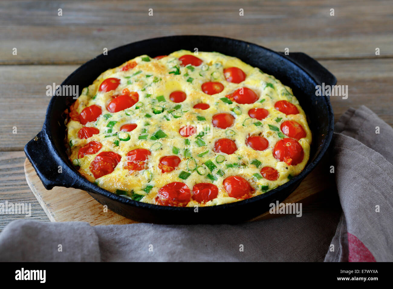 Frittata with Tomatoes, food closeup - Stock Image
