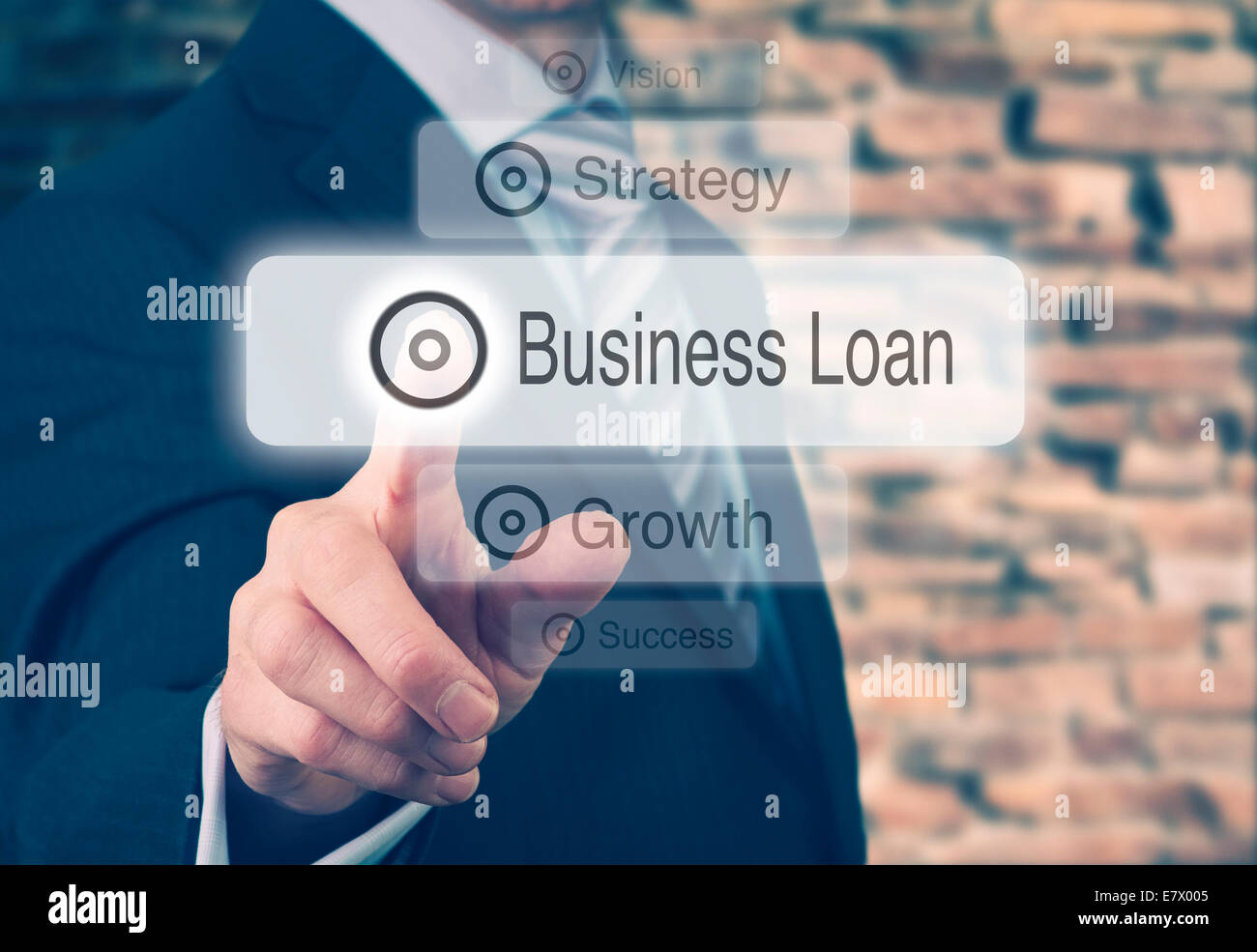 Businessman pressing a Business Loan concept button. - Stock Image