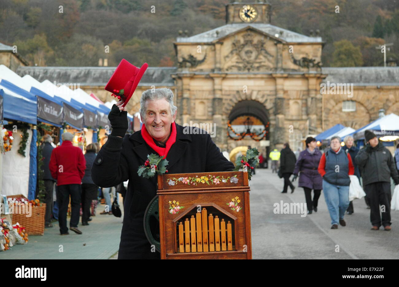 Organ grinder, Patrick Cooke entertains at Chatsworth Christmas Market, Chatsworth  House, Peak District