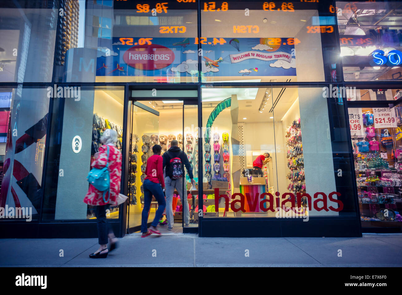 ecca731a2 Tourists pass the newly opened Havaianas store in Times Square in New York  - Stock Image