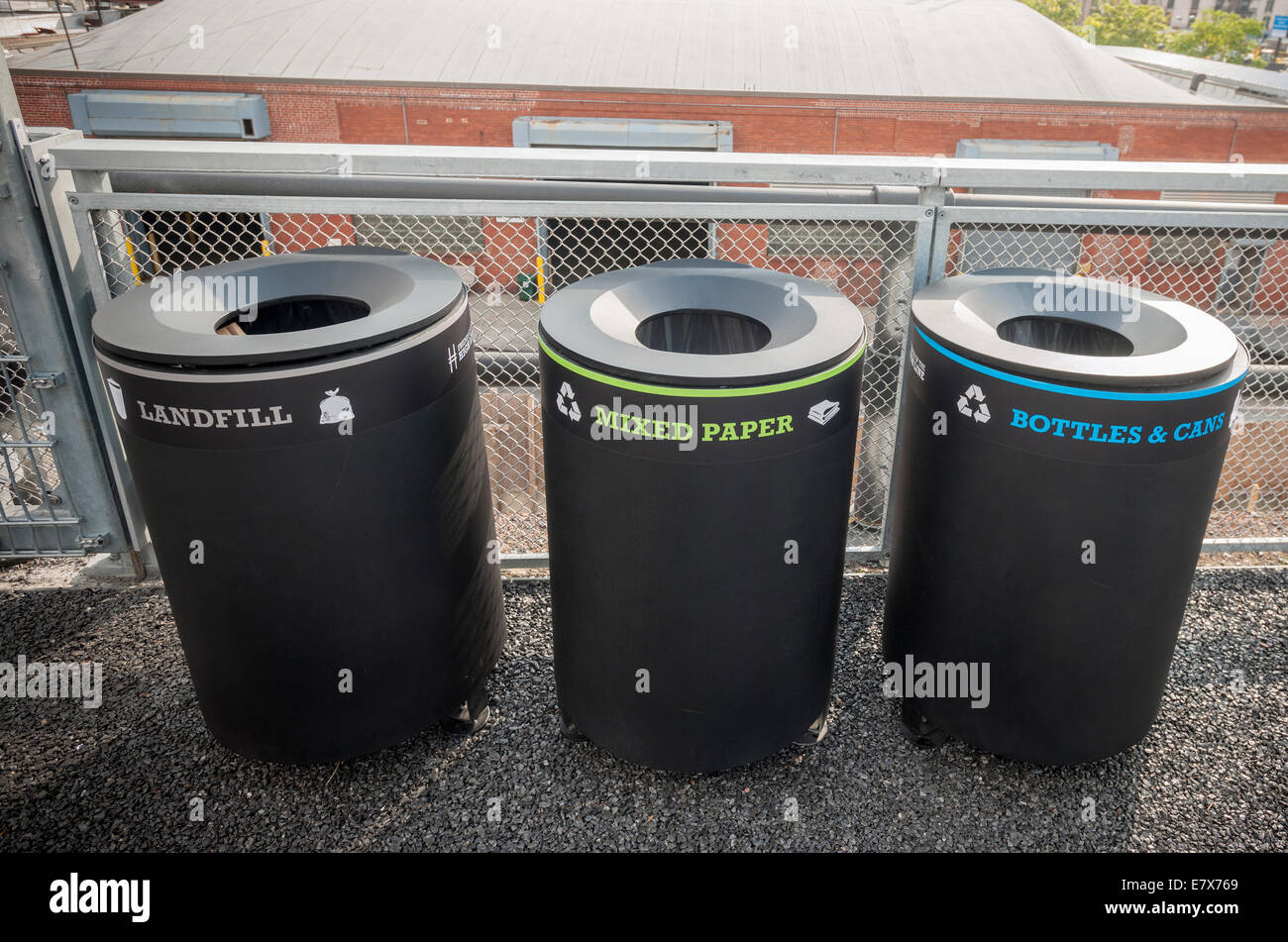 Labeled recycling bins are seen on the newly opened third phase of the high Line Park in New York - Stock Image