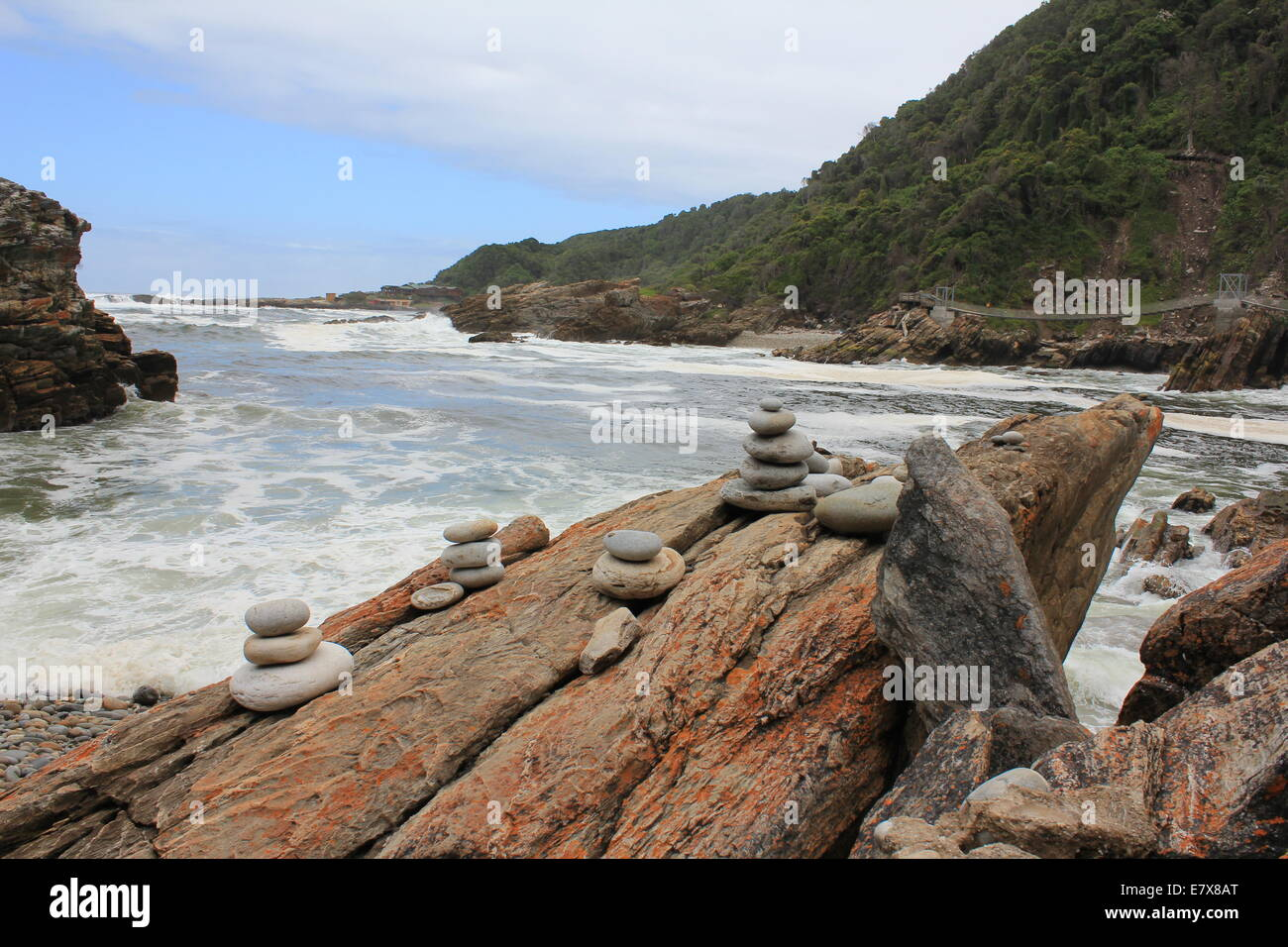 Several Cairn Rock Piles at River Mouth - Stock Image