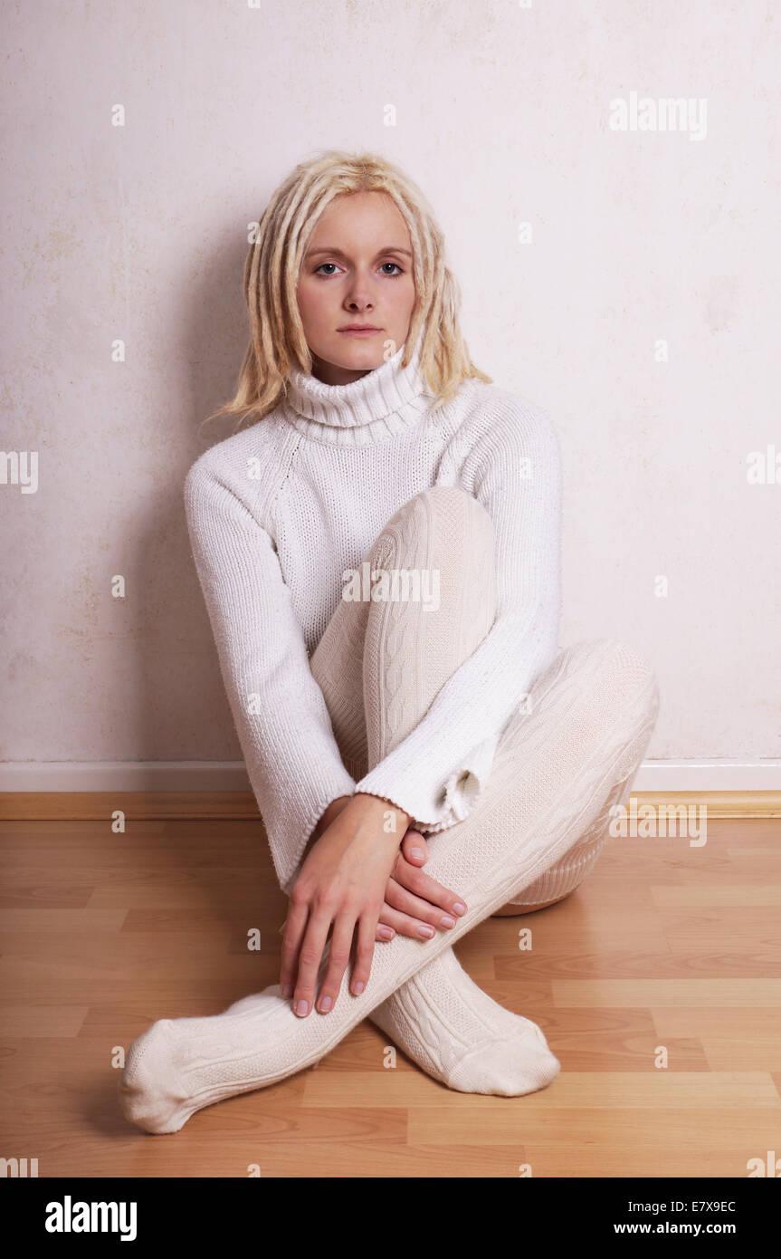 woman wearing turtleneck sweater and overknee socks Stock Photo