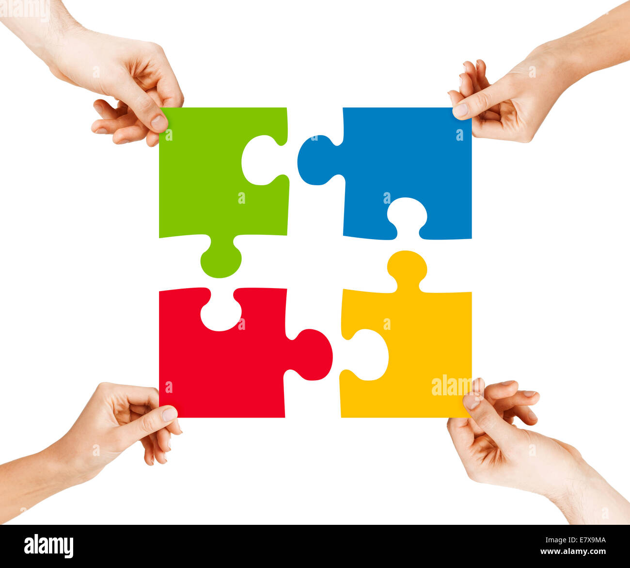 four hands connecting puzzle pieces stock photo 73722442 alamy