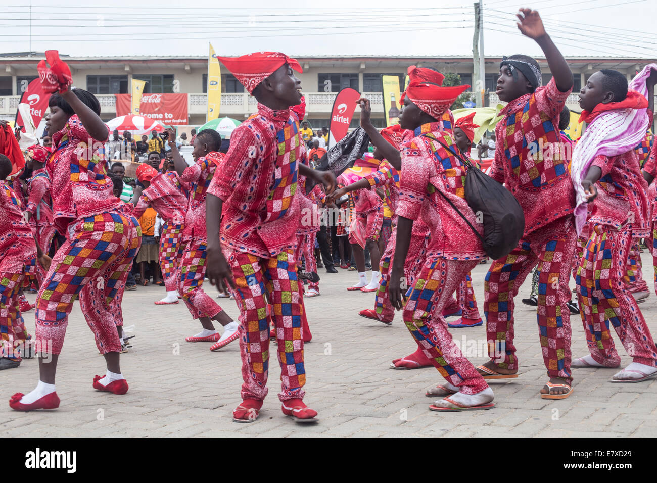 locals wearing new clothes and dancing in a group at fetu afayhe festival on cape coast - Stock Image