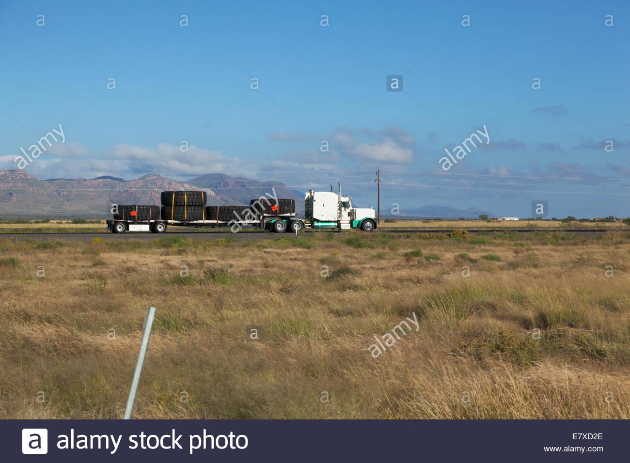 Truck hauling large tires wide load oversize Arizona - Stock Image