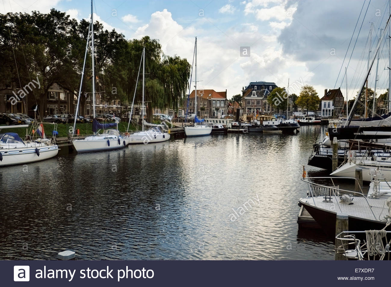 Sloops, houseboats and other personal watercraft are harbored in Enkhuizen's Oude Haven, or Old Harbor, near - Stock Image
