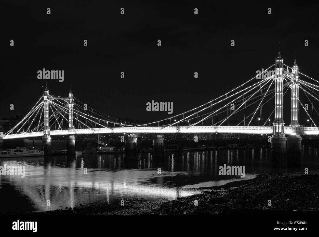B&W image of Albert Bridge in London, England, at night. - Stock Image