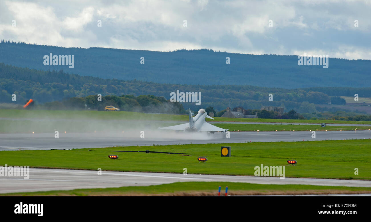 Eurofighter Typhoon FRG4 taking off from wet runway RAF Lossiemouth, Morayshire.  SCO 9125 - Stock Image