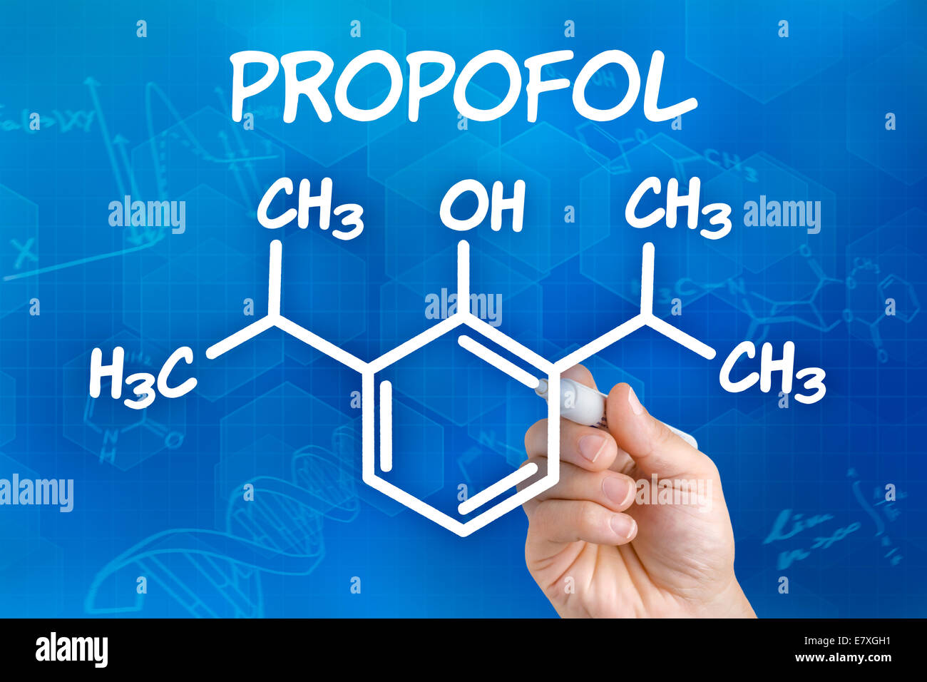 Hand with pen drawing the chemical formula of Propofol - Stock Image