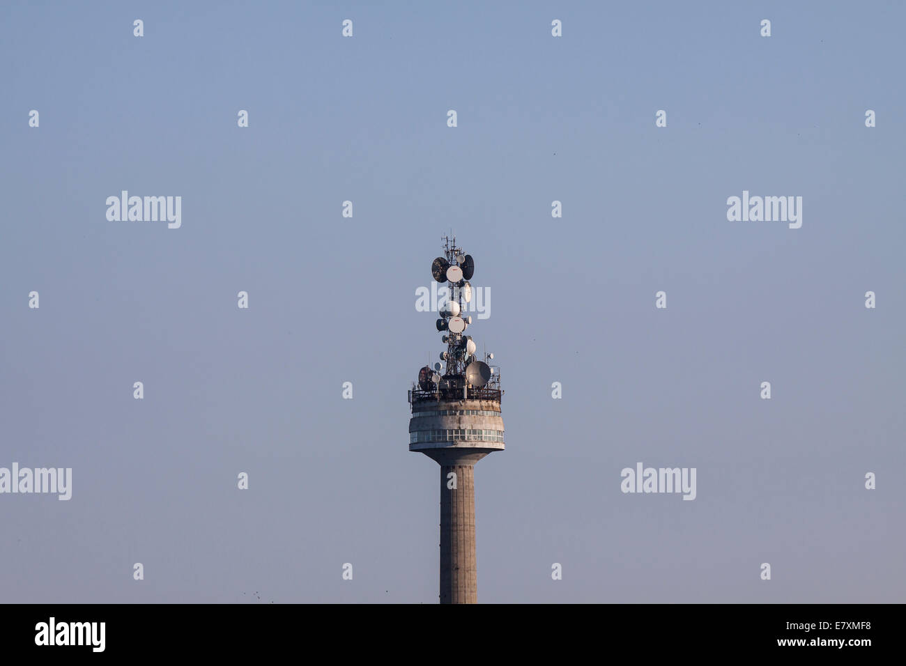 Television antennae tower with satellite dishes - Stock Image