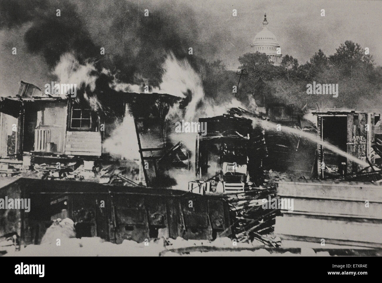 Shacks that members of the Bonus Army erected on the Anacostia Flats burning after the confrontation with the military. Stock Photo
