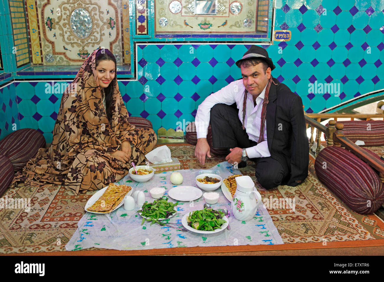 Iranian wedding couple having lunch in a traditional restaurant, Bazaar, Isfahan, Isfahan Province, Persia, Iran - Stock Image