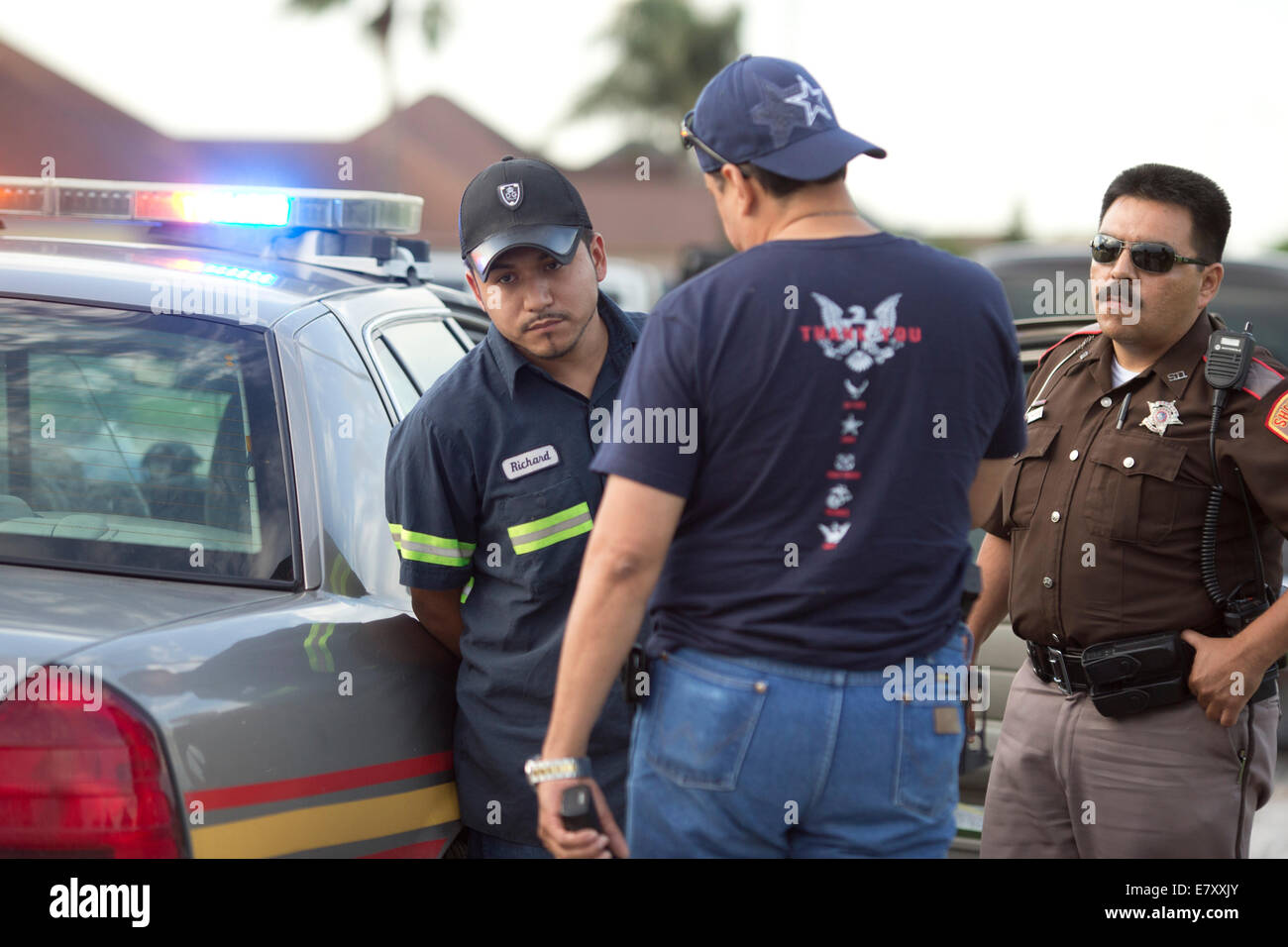 Brownsville, TX USA. 25th Sept, 2014.  Cameron County officers question a suspected illegal immigrant caught with - Stock Image