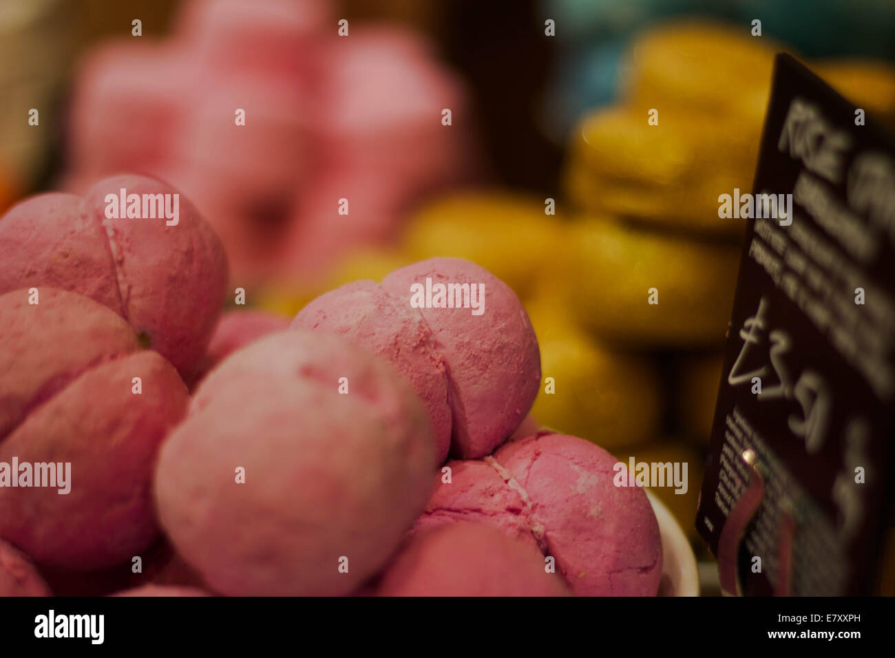 Bath bombs on display in a shop. - Stock Image