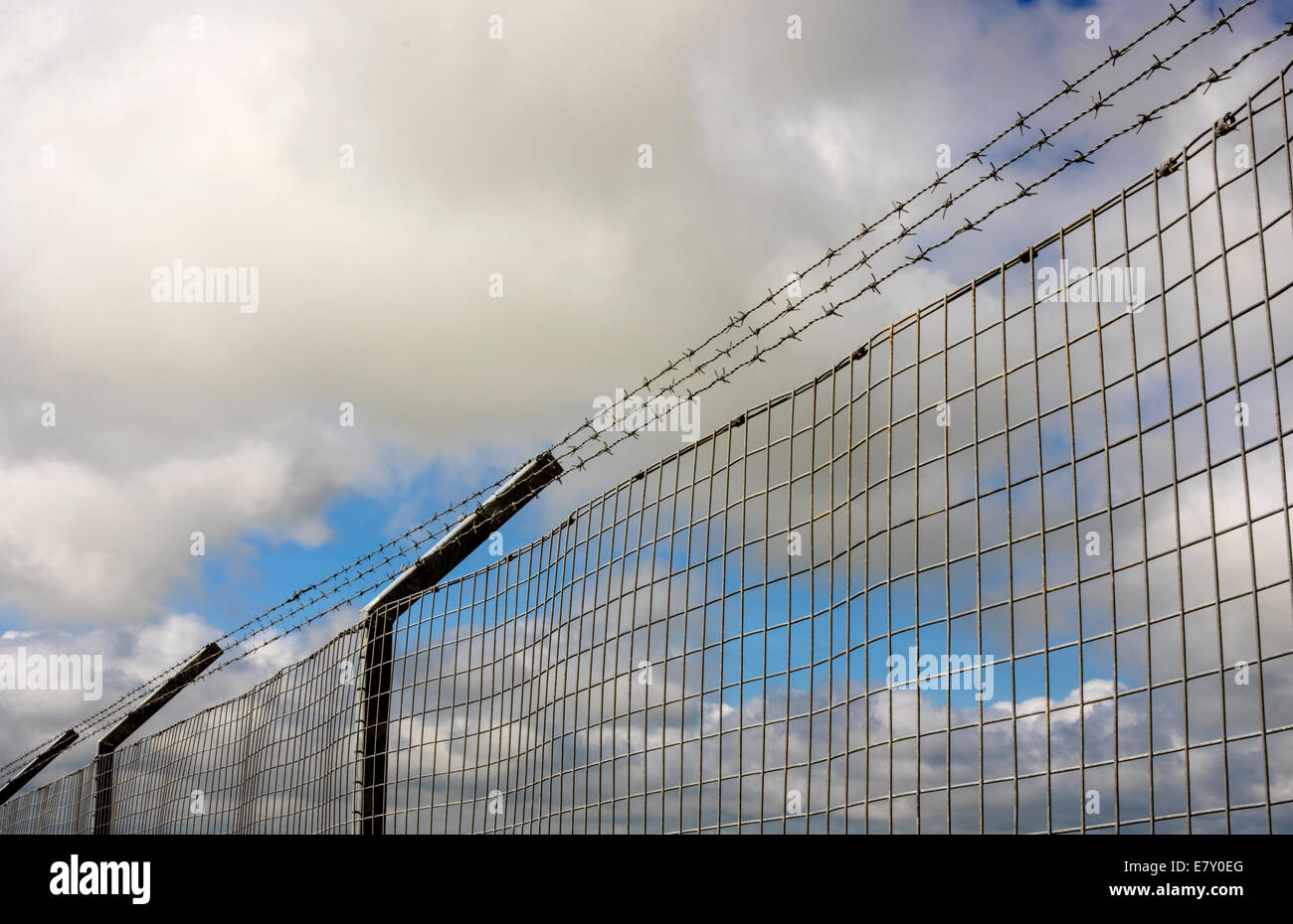 A fence around a compound to keep it secure - Stock Image