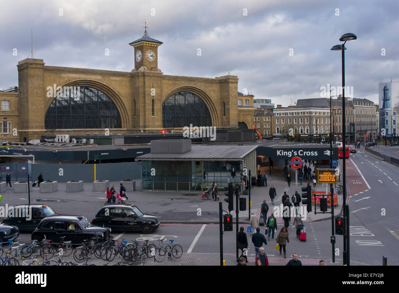 King's Cross railway station - a view of its impressive facade with consruction work, busy road junction & - Stock Image