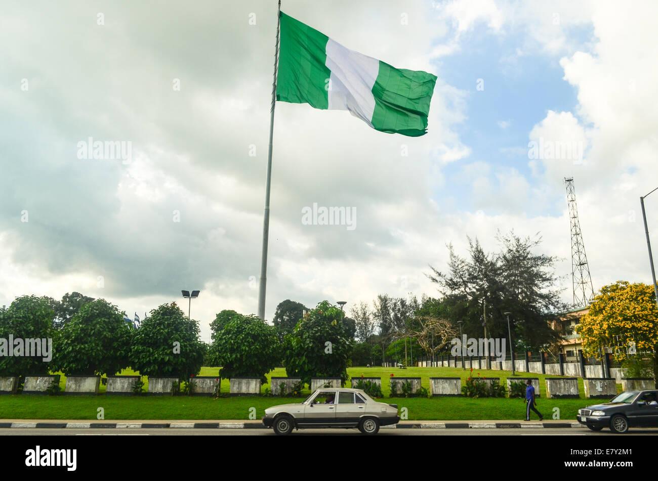 Big Nigerian flag in the wind of Calabar, Nigeria - Stock Image
