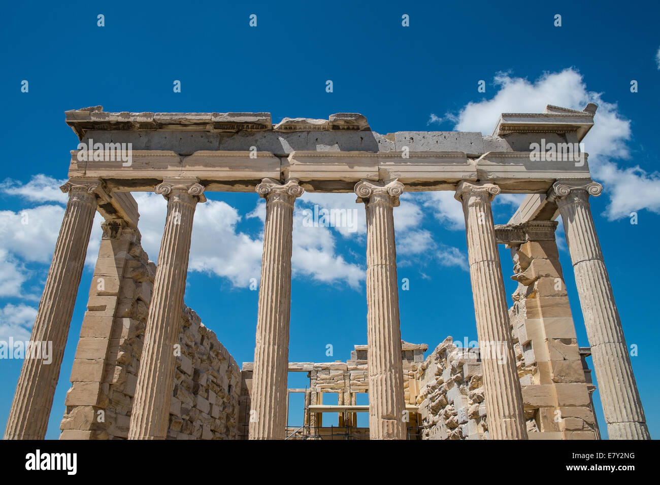 The Erechtheion or Erechtheum is an ancient Greek temple on the north side of the Acropolis of Athens in Greece - Stock Image