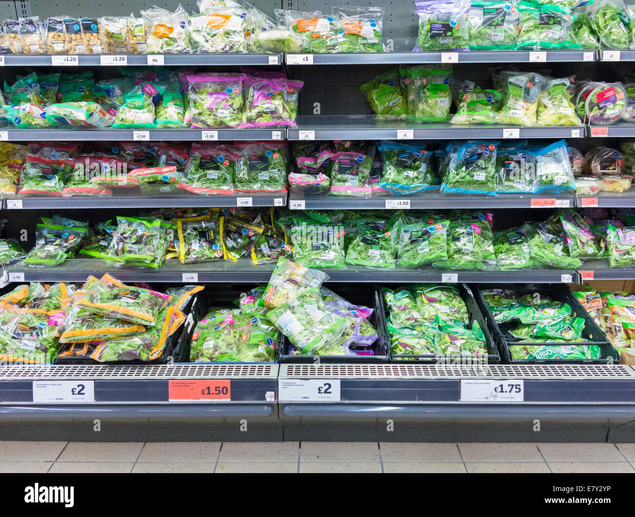 Bagged salads for sale in a supermarket, UK - Stock Image