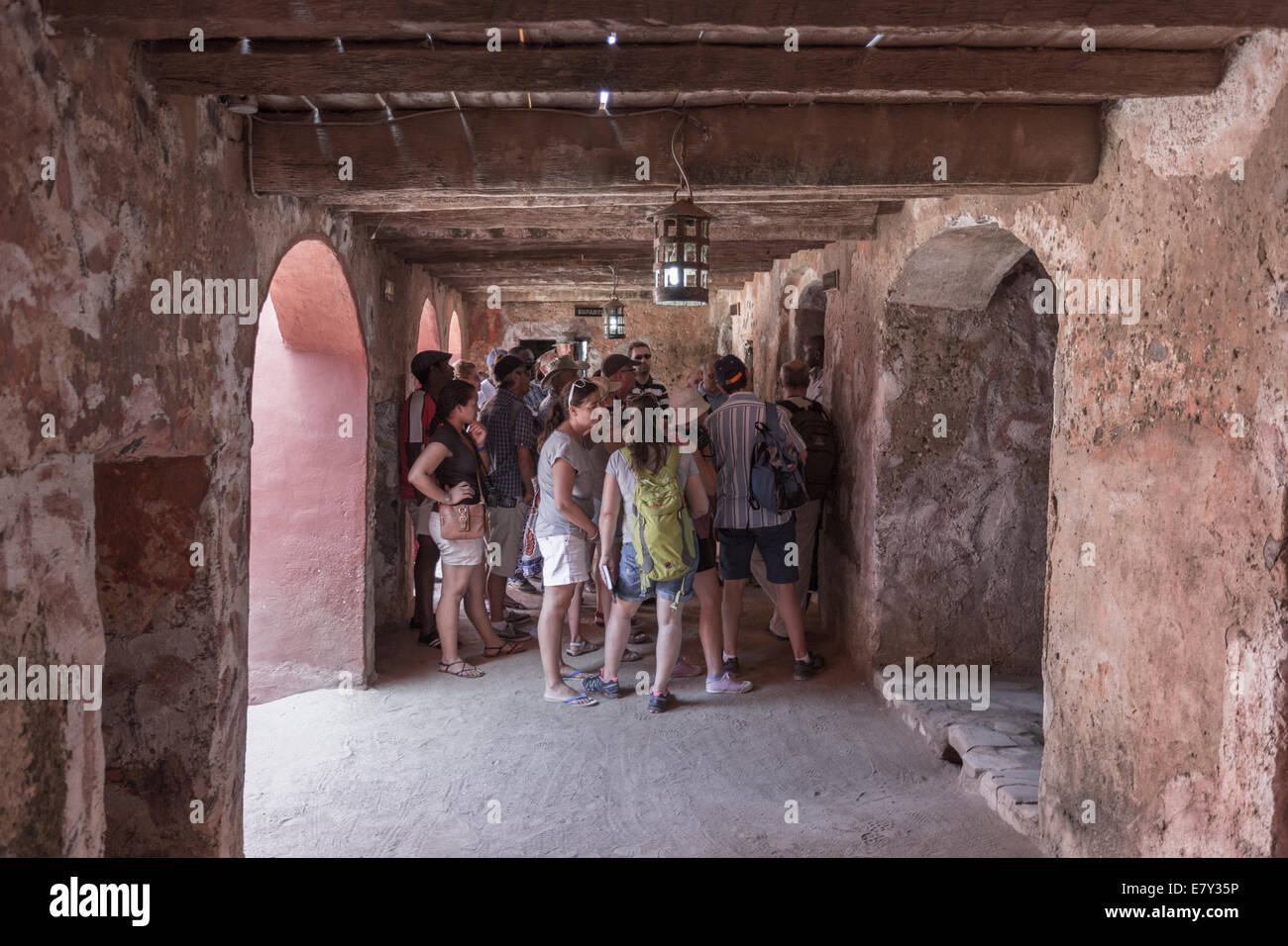 Touists visiting the House of Slaves are given detailed accounts of  how slaves were exported from Gorée Island. - Stock Image