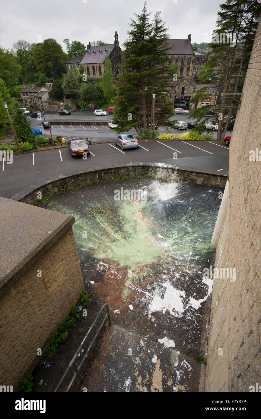 High view of criminal damage or vandalism caused by paint dropped & splattered outside in car park by vandals - Stock Image