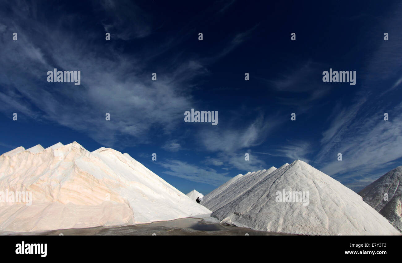 SAlt mounds dry under the sun in a local salt farm explotation in the island of Majorca, Spain - Stock Image