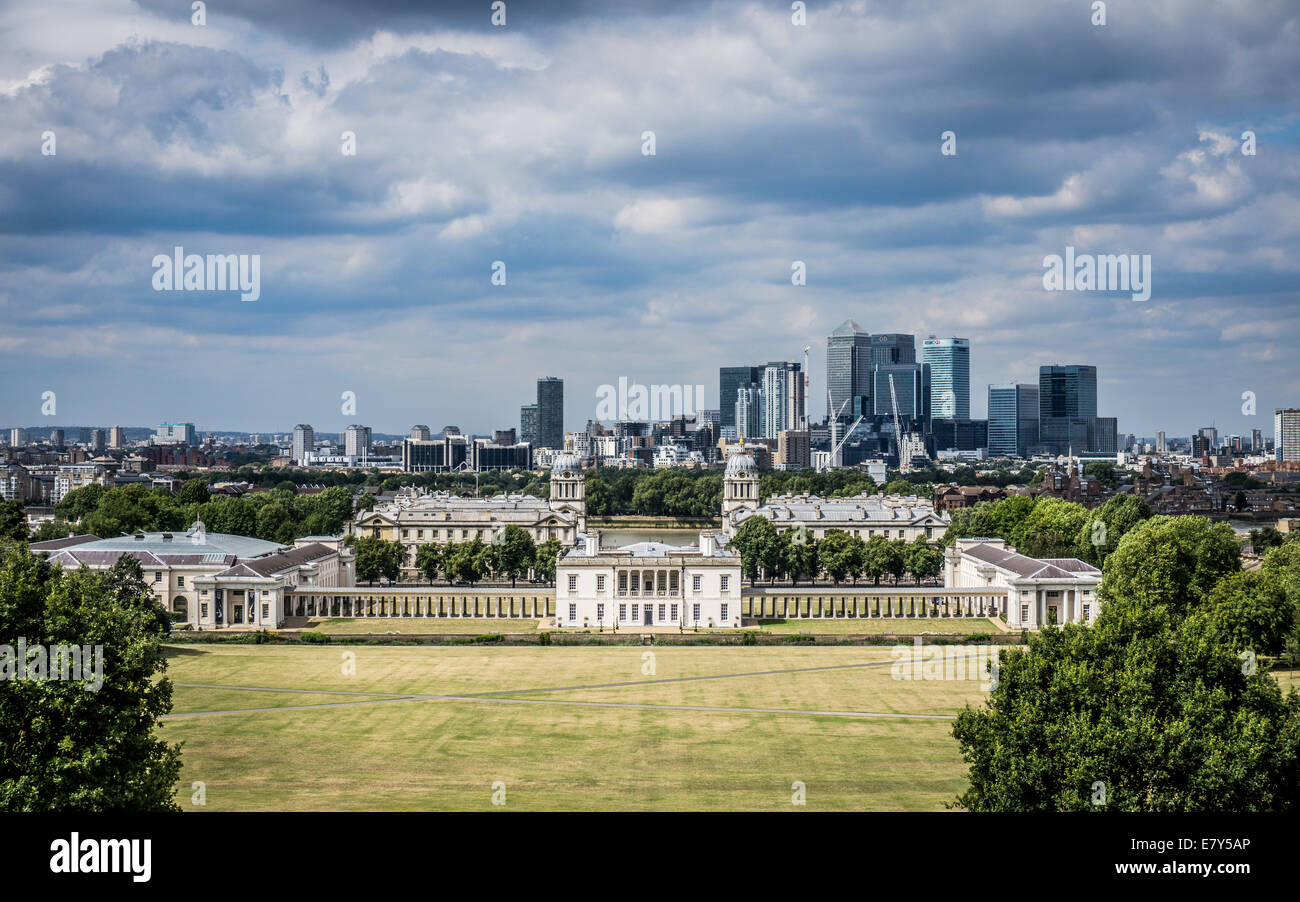 View of the National Maritime Museum and the Old Royal Naval College. Docklands and Canary Wharf in the distance. - Stock Image