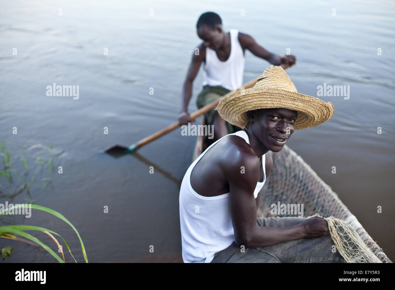 Young fisherman on a boat on The River Nile, South Sudan, Africa - Stock Image