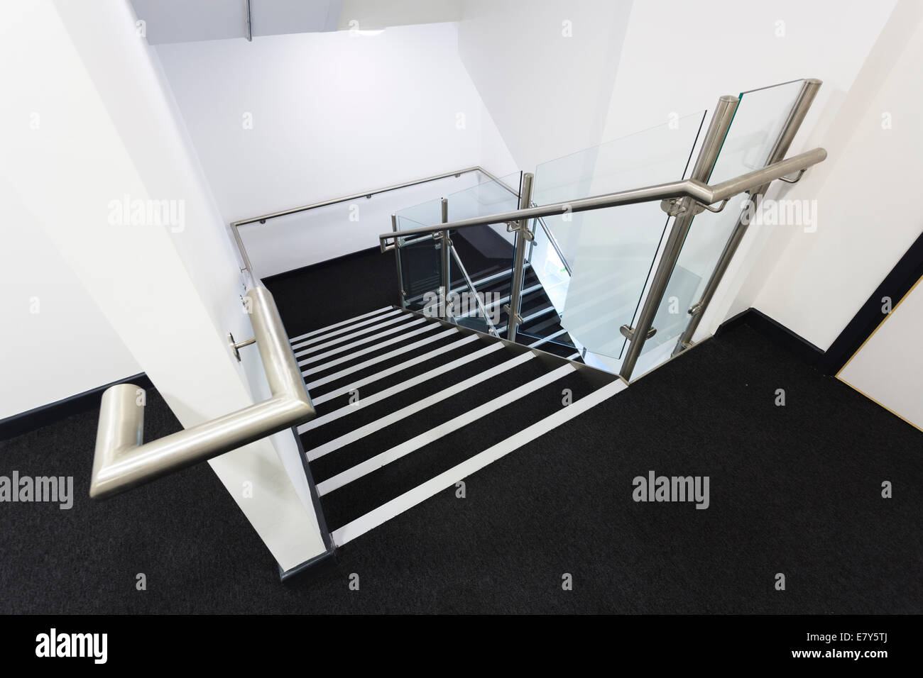 Looking down modern school staircase. - Stock Image