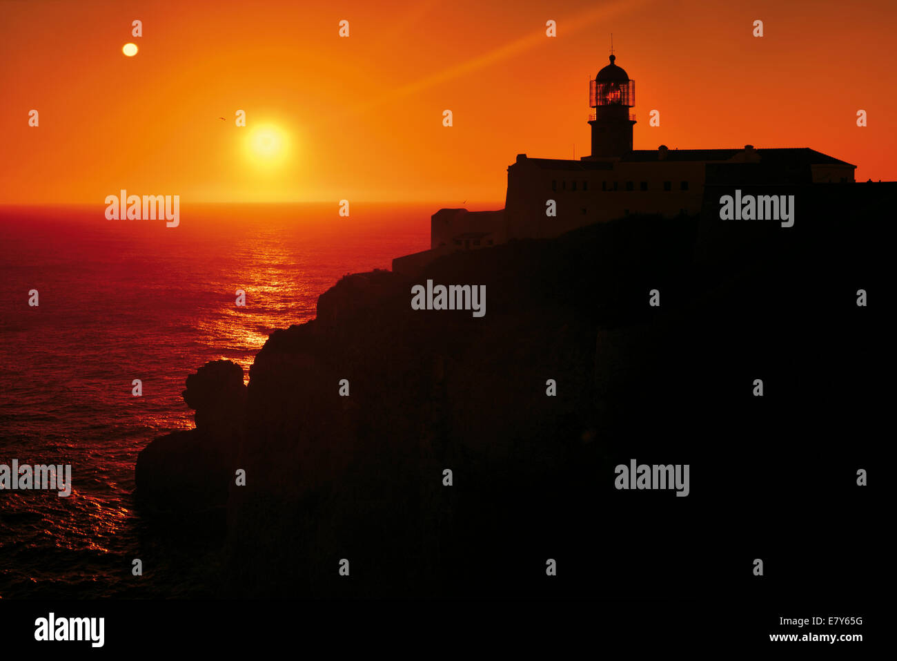 Portugal, Algarve: Sundown at the Lighthouse of Cape Saint Vincent Stock Photo