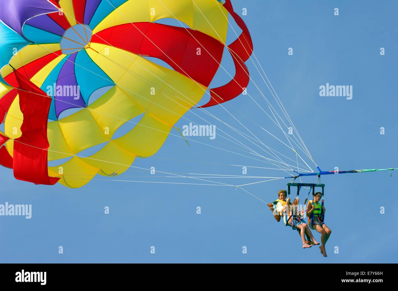 Three parasailors aloft at Sidi Mahres on the island of Djerba in Tunisia - Stock Image
