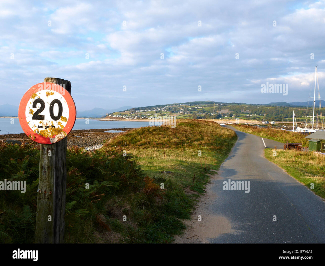 Homemade 20 MPH sign on Shell Island campsite with Harlech in the distance Wales UK - Stock Image