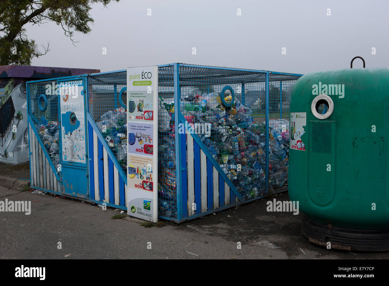 Recycling containers in a Car Park in the town of Plouescat, Brittany, France - Stock Image