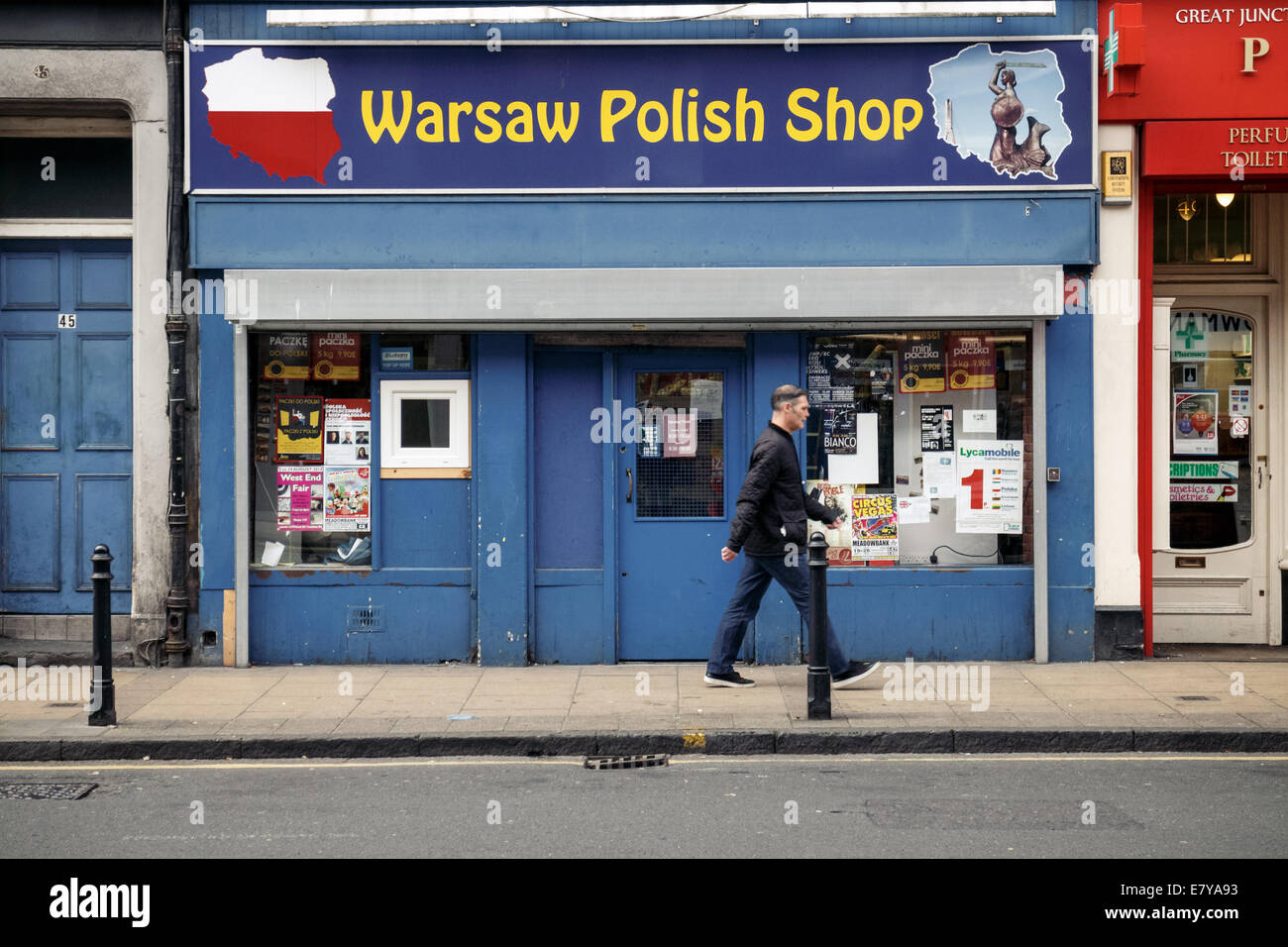 Man walking past Warsaw Polish Shop in Leith, Edinburgh - Stock Image