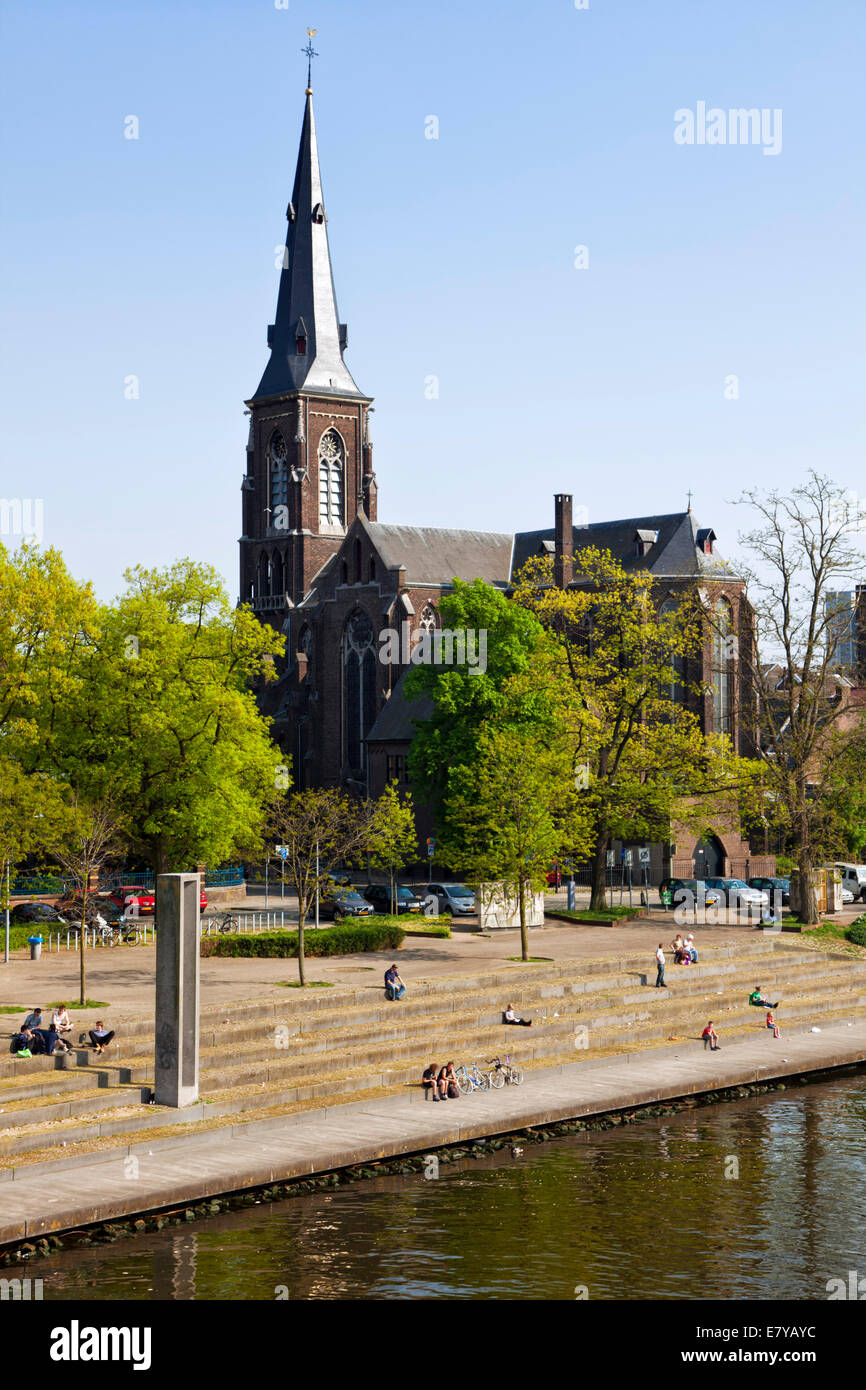 Saint Martinus church at Maastricht, shore of river Meuse in foreground - Stock Image
