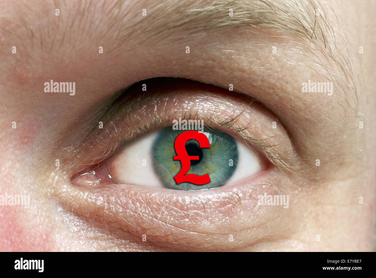 Pound symbol in eye, representing obsession with money. - Stock Image