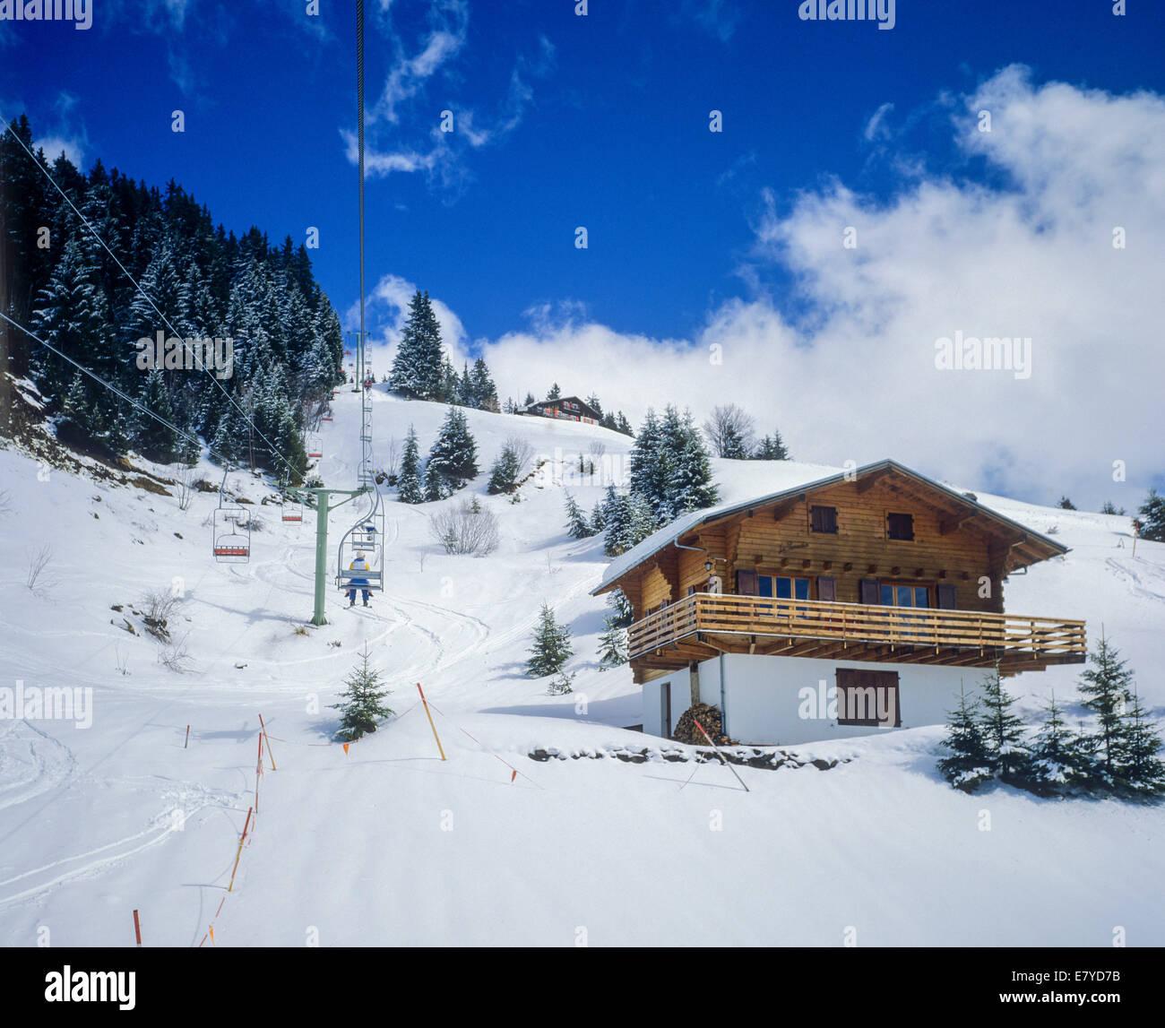 Chairlift and snowy chalet Morgins ski resort Les Portes du Soleil Swiss Alps Canton Valais Switzerland Europe Stock Photo