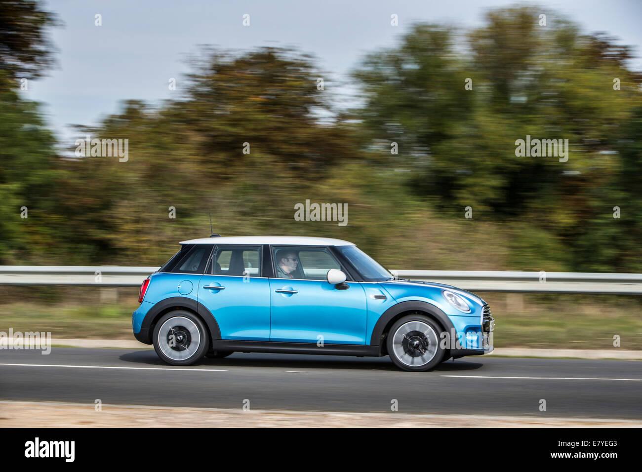 the new 2014 Mini 5 door cooper d in Blue - Stock Image