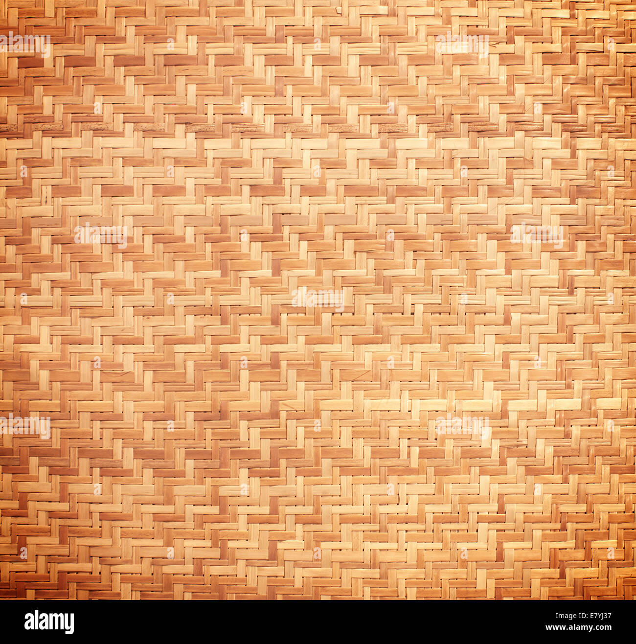 Woven rattan with natural patterns, vintage wall. - Stock Image