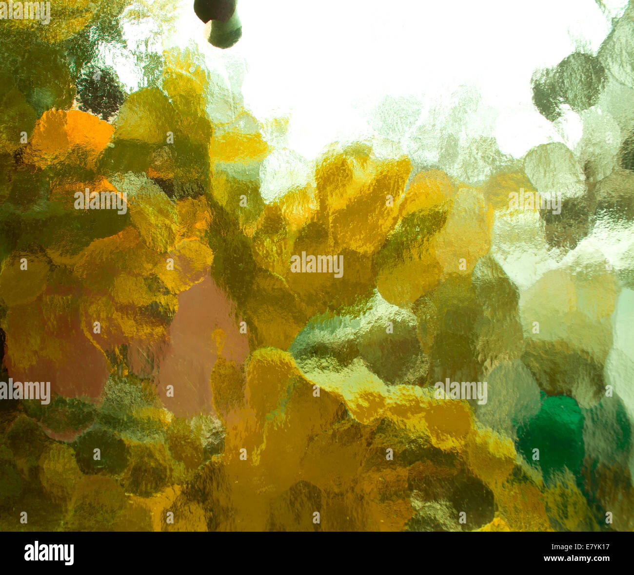 Frosted glass texture of an abstract colorful scene. - Stock Image