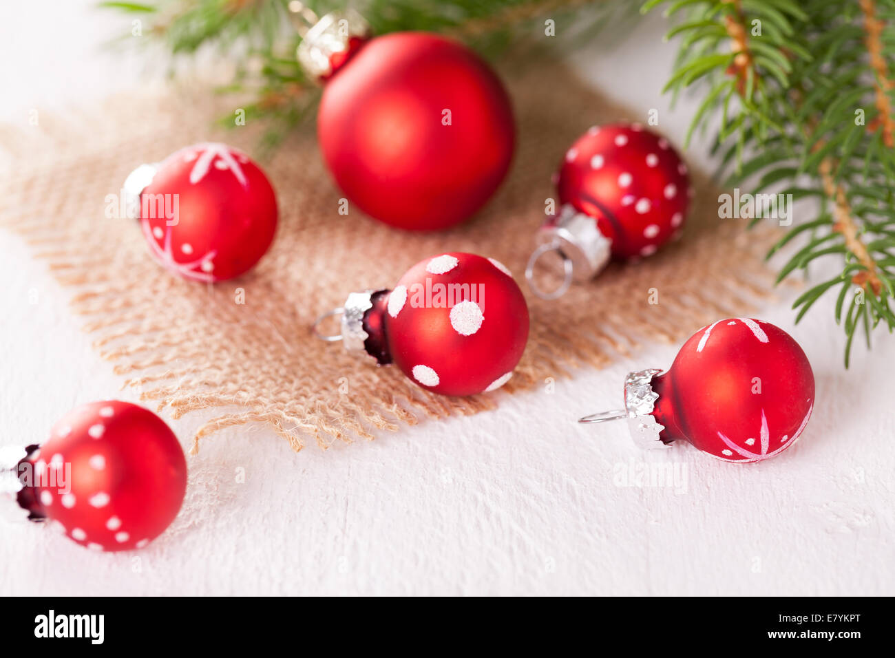 Pretty red polka dot Christmas bauble in a rustic Xmas seasonal ...