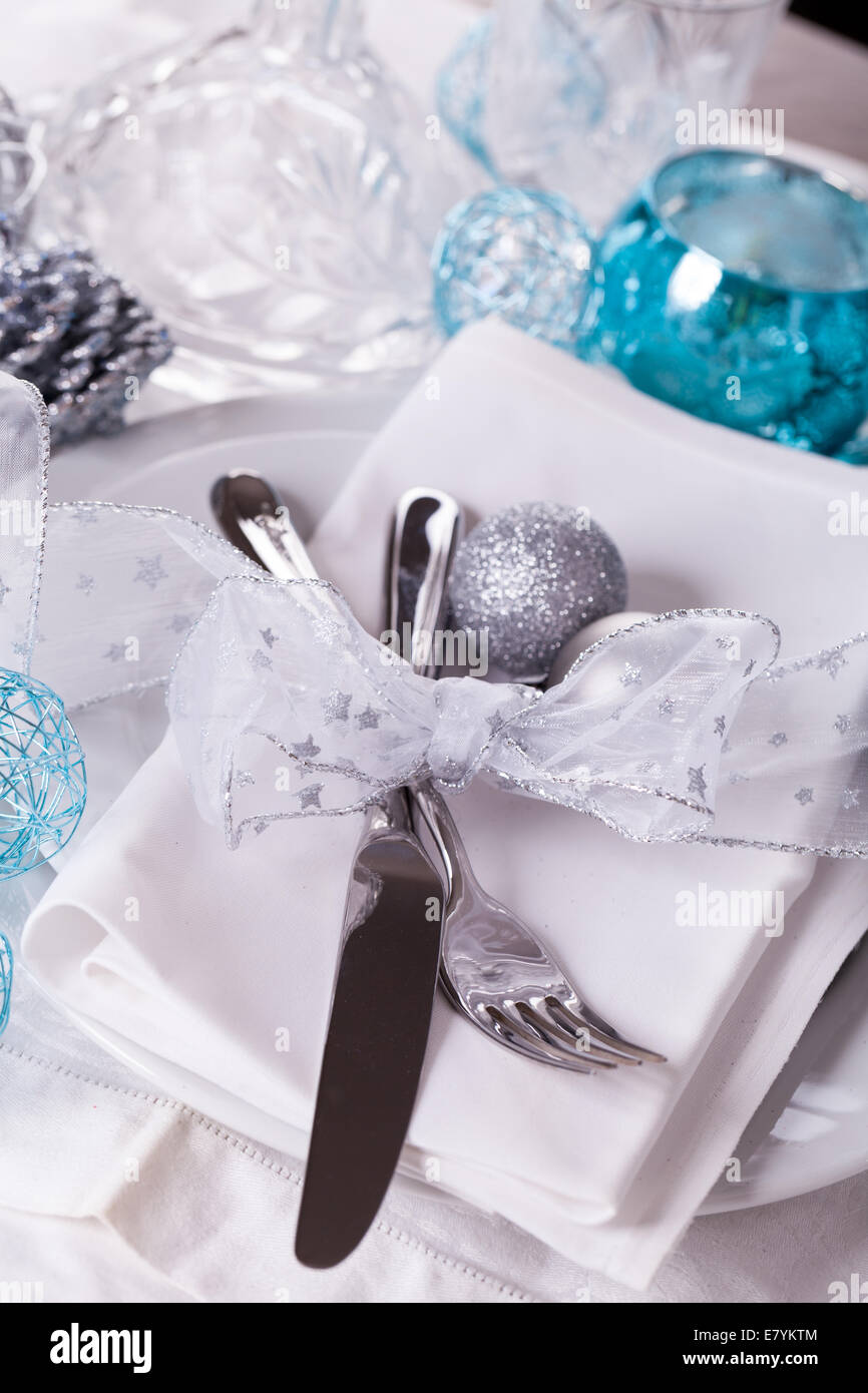 Stylish blue and silver Christmas table setting with a pretty Stock ...