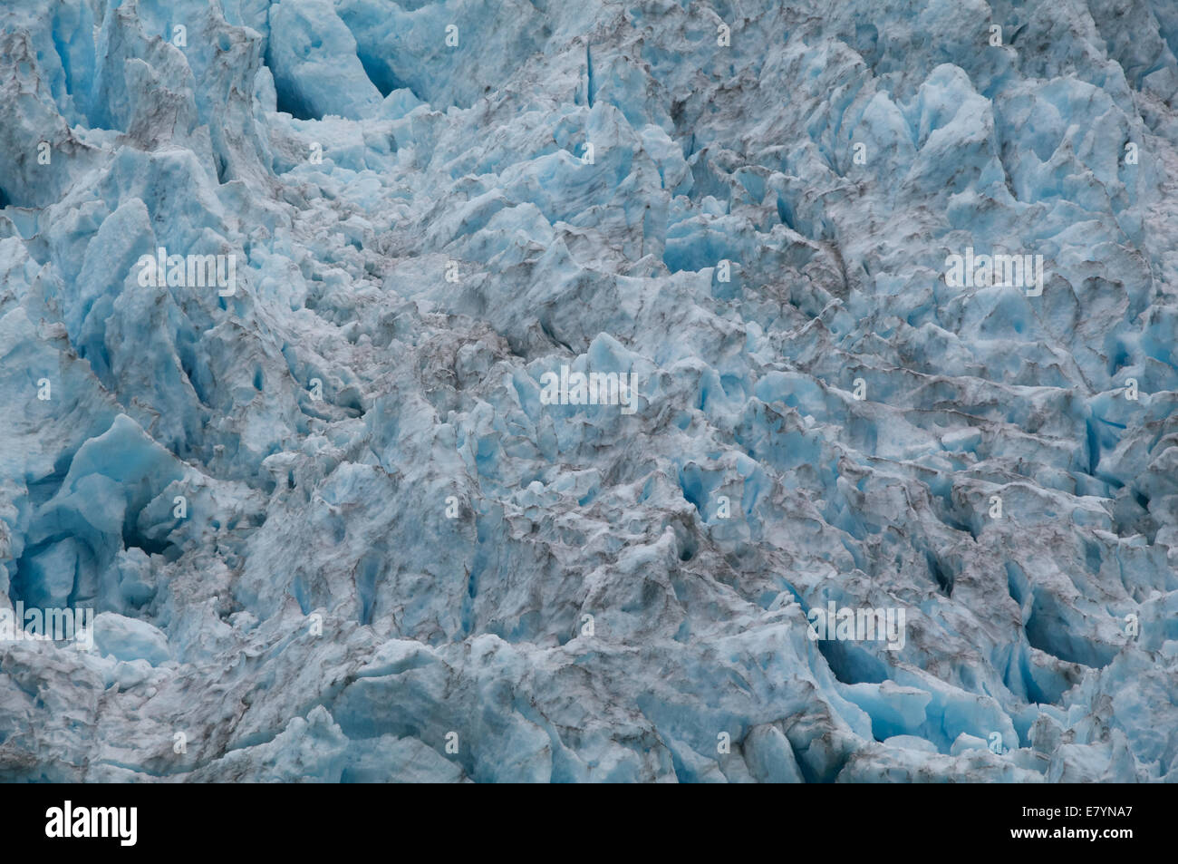 A close-up of the rough pattern of ice on Northwestern Glacier in Kenai Fjords National Park, Alaska. - Stock Image