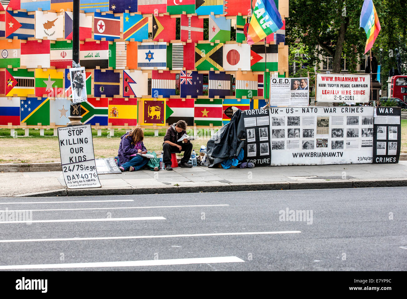 LONDON, ENGLAND - May 2012: Activists take turns on Parliament Square, in front of London's Parliement to protest - Stock Image
